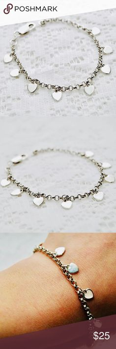 """Sterling Silver Candy Hearts Charm Bracelet 7.25"""" Up for your consideration is an adorable heart charm bracelet crafted from solid sterling silver.  - Cable link chain bracelet with 8 candy heart charms spread across, all polished finish - Will fit up to 7.25"""" wrist - Marked 925 Italy, 7.4 grams - Some light surface scratching, charms show some wear, charms are not perfectly evenly seperated onto the links of the bracelet, some are slightly offset but does not effect wear Jewelry Bracelets"""
