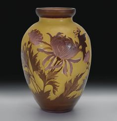 A GALLE CAMEO GLASS VASE, CIRCA 1904  of tapering ovoid form, overlaid and acid etched with variegated purple chrysanthemums to yellow ground, signed in cameo Galle 29.2CM HIGH