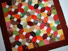 Quilted Table Topper , Autumn Scrappy Quilt , Rust/Brown/Gold/Green , Reversible by VillageQuilts on Etsy