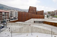 Perforated corten-steel facade. School building in Spain. OKE / aq4 arquitectura