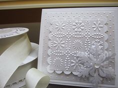 handmade winter card ... white on white on white ... lots of layers ... two layers with different embossing folder texture ... big die cut snowflake in the corner ...  awesome!!