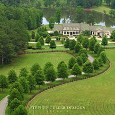 I have no desire to have a house this enormous but I do love the tree lined drive and the nearby lake / pond