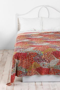 Maybe really simple bedding with fun pillows and a tapestry laying across. Then, I can paint the walls a bright color and not overwhelm the space.