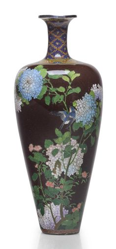 A cloisonné enamel vase Meiji period (late 19th century), attributed to the workshop of Namikawa Yasuyuki The slender baluster vase with a long flared neck decorated in polychrome enamels and silver wires with hydrangeas and birds on a dark brown ground, the neck and shoulder decorated with florets