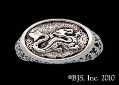 The Asha'man Dragon Pin™ from our officially licensed Wheel of Time™ jewelry line.  The dragon pin was awarded and worn by those men promoted to full Asha'man™ level, similar to the level of full Aes Sedai™.