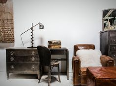 Industrial metal desk and leather club chair with ottoman. Custom decor and antique furnishings. http://bdantiques.com/