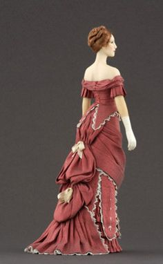 NAME: Jane PERIOD: 1877-1879 Ball dress in shantung silk trimmed with cotton lace, flounces, silk thread embroideries made by hand and ribbons.