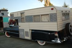 Photo of a vintage camper unit that has been skillfully grafted onto a vintage 1952 Cadillac