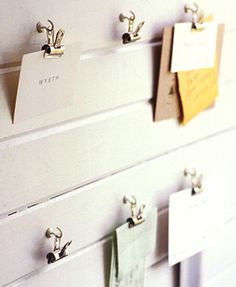 wall clip organization - this is one of my favorite cheap & easy ways to display art, kid art, postcards, etc.