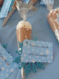 Winter Wonderland guest favor. Hot chocolate mix with marshmallows along with a snowflake Christmas ornament. Tag printed on scrapbook paper and cut using decorative edge scissors. #anamadeit