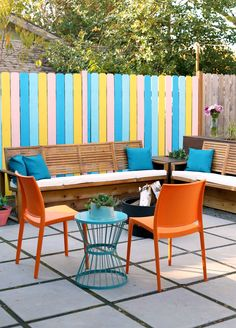 It's here! Our Colorful Small Space Patio Makeover: with Before and After photos! Painted fence, DIYs, and more! Head on over to see the final result.
