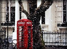 london in the falling snow.