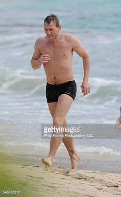 British actor Daniel Craig and his girfriend Satsuki Mitchell with friends have fun with waves on the beach of Salines