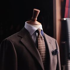 New in the shop, a beautiful warm grey/brown check from Carlo Barbera in our house AMJ03 model by Ring Jacket.  (at The Armoury Hong Kong)