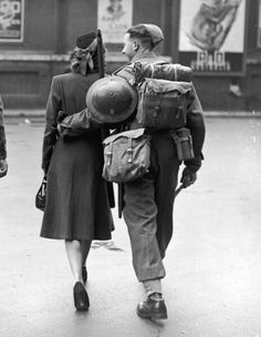 A young woman arriving to see her soldier boyfriend off from a London railway station, 17th June 1940. (Photo by J. A. Hampton/Topical Press Agency/Hulton Archive/Getty Images)
