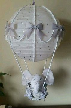 Hot air balloon light shade with a Dumbo comforter looks stunning in a nursery