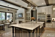 Monochromatic scheme, white carrera island, cabinet finishes, open floor plan....absolutely love this!!
