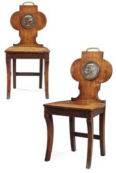A PAIR OF IRISH REGENCY MAHOGANY HALL CHAIRS  CIRCA 1815  Each centred by roundels painted with the FitzGerald arms below a brass ropetwist handle, on sabre legs  35 in. (89 cm.) high; 16¼ in. (41.5 cm.) wide; 16½ in. (42 cm.) deep (2)