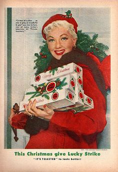 I printed a bunch of vintage Christmas ads like this one (mostly found via Google Image Search), four to a page, cut them out and then glued them to cardboard. I'm going to punch holes in the tops and string ribbon through for kitschy little ornaments