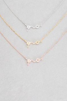 Red wine molecule charm necklace in gold, rose gold, and silver.