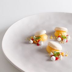 Macaron, lemon curd, and white chocolate by @simon_oliver #TheArtOfPlating