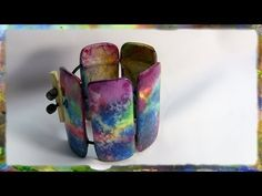 How To Make a Unique  Watercolor Paper Bracelet, Part 2.  In this two part video series I demonstrate how to construct a beautiful watercolor paper bracelet  in easy to follow, step by step instructions.    Visit http://www.watercolorjewelry.com to learn more about my jewelry creations.  The Watercolor Paper Bracelet is a uniquely original and beau...