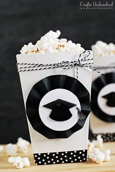 Graduation Party Popcorn Boxes. Embellish the white boxes to coordinate with your party theme. Make the rosettes with a scoring board and black cardstock to finish off the popcorn boxes with a graduation party design. http://hative.com/graduation-party-ideas/