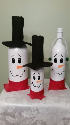 These adorable snowman wine bottles can add a special touch to your winter decor. Place on the mantle or use as a table centerpiece.  The set comes as shown. Mr. And Mrs. Snowman made from wine bottles and a child made from a beer bottle. The hats and earmuffs are included in the purchase.  Please let me know if you would like the smaller snowman with a hat to represent a boy or earmuffs to represent a girl.  All bottles are hand painted so the faces may vary in what you see in the picture…