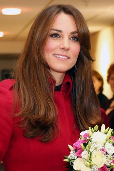 Kate Middleton works her signature blow-dried brunette locks in a perfectly-places down-do with just a few flicked waves to give her hair some movement for her visit to a Welsh Rugby Reception and Match, November 24, 2012.