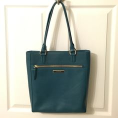 """GORGEOUS Teal Cole Haan Purse❤️ The Melbourne Magazine Tote by Cole Haan. This is the most beautiful handbag! The color is called """"Ernest Teal"""". The pictures do not do the purse justice. It has one large outside zipper pocket, one inside zipper pocket, and two small inside pockets to store a cell phone or other small trinkets. I only used it for a month and it is in excellent condition. Cole Haan Bags Totes"""