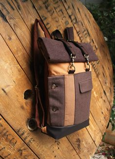 Purple brown & soft peach upcycled roll top rucksack using parts from a striped suit jacket, by 'eating the goober'from the suit has been used on the front ideal for accessing basic things (such as wallet,