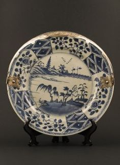Qianlong - Large blue and white sweetmeat dish with early Chinese willow decor, silver handle later mounted in Holland in 1859