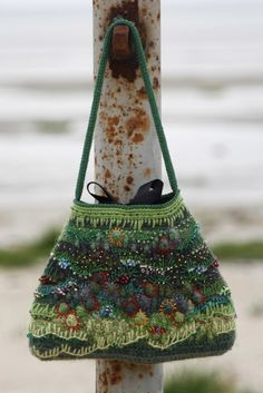 How unique, embroidery over single crochet stitch bag. Love embroidery plus gorgeous bag!!