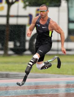 Oscar Pistorius of South Africa, who wears carbon fibre blades, will become the first double amputee to compete in the Olympics. He was selected to run the 400 meters individual competition in London. (AP Photo/Paolo Giovannini)