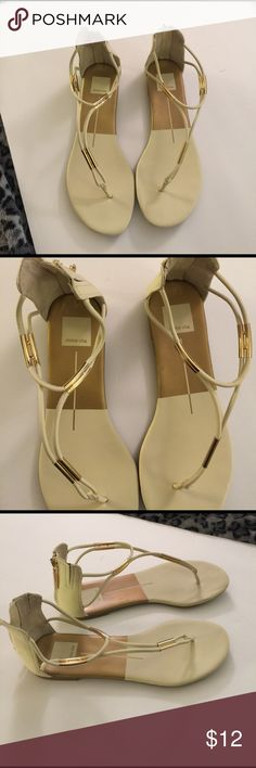 Target Cream Flat Sandals Cream and gold color, flats, zipper in back, wore these skit but still in good condition, the left shoes has a few spots on the sole part. Bought these at Target. Size 9.5 DV by Dolce Vita Shoes Sandals