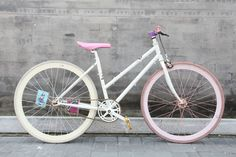 This pretty in pink bike, is comprised of a steel females frame as it does not have a horizontal top tube, making this one more comfortable for all you ladies out there looking to ride a fixed gear bike!