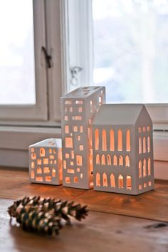 The Urbania Tea Light collection from Danish design icon, Kahler, comprises tea light holders handmade into the shapes of various urban buildings (in this case, the Apartment House). The candleholders Pottery Houses, Slab Pottery, Ceramic Pottery, Ceramic Art, Ceramic Lantern, Ceramic Candle Holders, Clay Houses, Ceramic Houses, Style Deco
