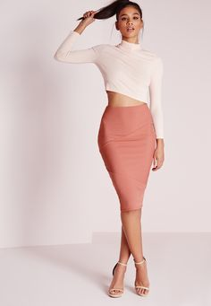 There's nothing better than the feel of stretchy ribbed fabric as it hugs your curves and flatters your figure to give you a totally sexy bodycon-tagious look. This salmon midi skirt ticks all our style boxes for doing just that. Make the m...