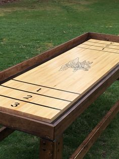 Own your own bar style shuffleboard table!! Custom made with any logo or color paint... Includes vinyl decals, includes pucks, cup holders and scoring plaque! Wont find it cheaper anywhere!  Dimensions: Length- 96 (84 playing surface) Height- 32 Width- 30   This item is made to order. Please indicate the logo you would like in a note to the seller. Attaching a photo of the specific logo you would like is helpful. Minimal assembly required.  Ships to USA and price depends on location…