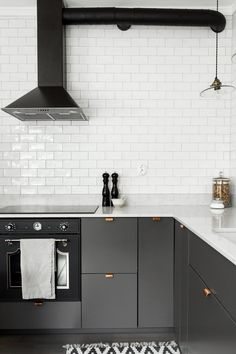 Grey kitchen with copper handles