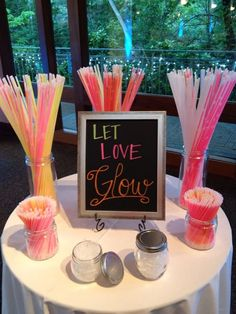 "You can order a pack of 50 glow sticks here for $25.49. The ""Let Love Glow"" sign can be found here for $25."