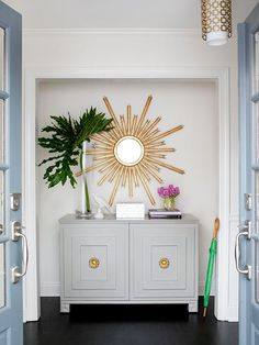 Gray furniture with gold accents.  And that mirror!  Deign by Melanie Turner