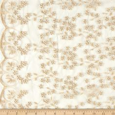 Telio Daisy Embroidery Gold from @fabricdotcom  Delicate and classic, this sheer lace features an embroidered floral design and scalloped edges. This beautiful lace also has stiff feel for a more structured look. This lace fabric is appropriate for overlays on skirts or dresses, feminine apparel accents and wraps or shrugs.