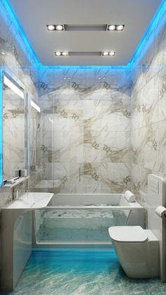 Bad aus weißem Marmor und mit indirekter Beleuchtung in Blau