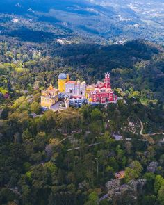 Pena palace from the air. Pena Palace is an incredible castle located in the heart of Sintra Portugal. Come explore this place with me, and find out everything you need to know for your travels. Road Trip Portugal, Portugal Travel, Spain And Portugal, Places To Travel, Travel Destinations, Places To Visit, Sintra Portugal Castle, Pena Palace, Bon Plan Voyage
