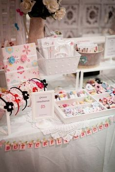 Lovely display - White tableclothes with doilies and white container/s display make product pop.: