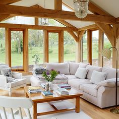 Living room with stunning garden views | Living room decorating | Country Homes & Interiors | Housetohome.co.uk