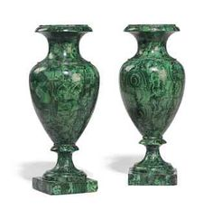 A PAIR OF RUSSIAN MALACHITE-VENEERED VASES  MID-19TH CENTURY  Each with a ciruclar lip above a waisted neck and tapering ovoid body, on a spreading socle and square foot  13¾ in. (35 cm.) high (2)