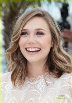 Elizabeth Olsen;  she reminds me of Scarlett Johansson.  She Sounds like her, and has some of her mannerisms.  I think she will be the true star of the Olsen family.