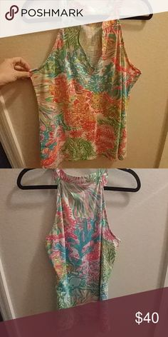 Lilly Pulitzer Tank Like new, worn once. Lilly Pulitzer tank. It looks more like the top picture, my lighting was not ideal for this shirt. Lilly Pulitzer Tops Tank Tops